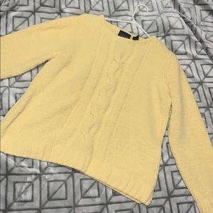 a sunflower yellow sweater